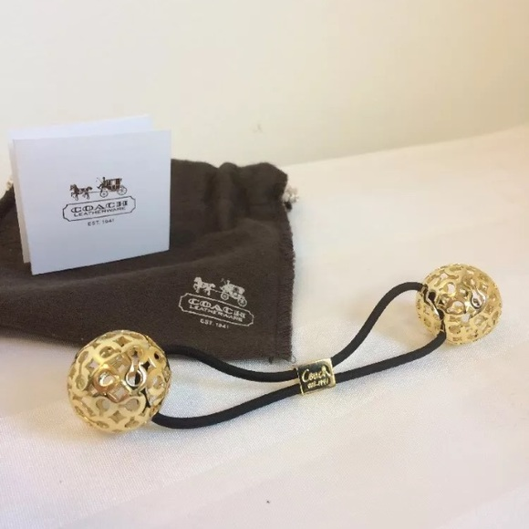 Coach Accessories - Coach ponytail holder gold double ball hair tie 12bcc347f06